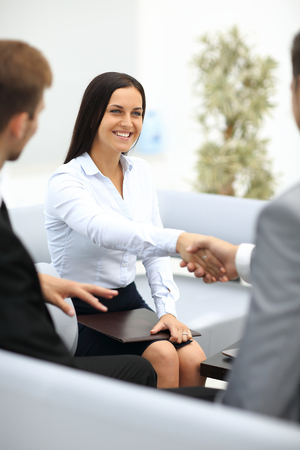 Young woman shaking hands after being hired